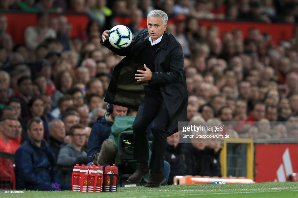 Man Utd manager Jose Mourinho catches the ball during the Premier League match between Manchester United and Tottenham Hotspur at Old Trafford on August 27, 2018 in Manchester, England.