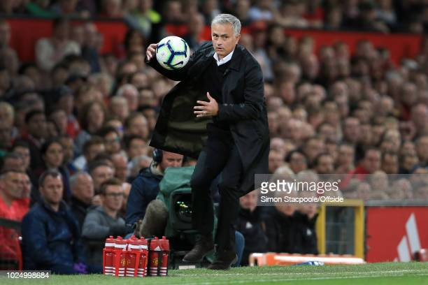 Man Utd manager Jose Mourinho catches the ball during the Premier League match between Manchester United and Tottenham Hotspur at Old Trafford on...