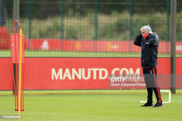 Man Utd manager Jose Mourinho dons a snood during a training session ahead of their UEFA Champions League Group H match against Valencia at the Aon...