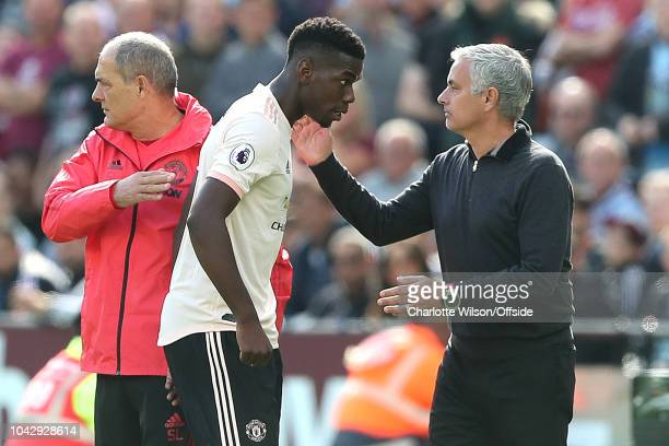Man Utd manager Jose Mourinho pats Paul Pogba of Man Utd on the back as he is subbed off during the Premier League match between West Ham United and...
