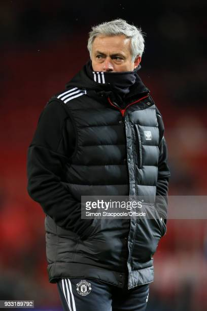 Man Utd manager Jose Mourinho wears a snood during The Emirates FA Cup Quarter Final match between Manchester United and Brighton and Hove Albion at...