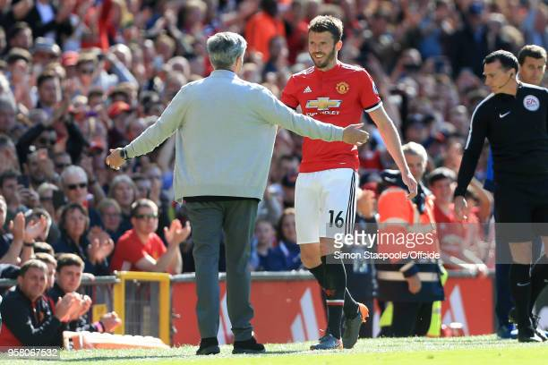 Man Utd manager Jose Mourinho welcomes Michael Carrick of Man Utd off the pitch after substituting him during the Premier League match between...