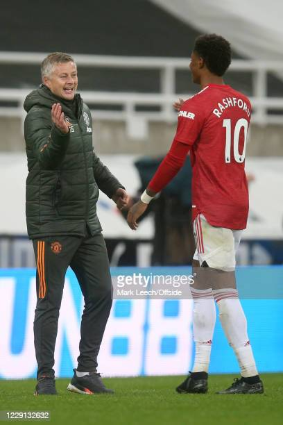 Man Utd manager Ole Gunnar Solskjaer celebrates with Marcus Rashford of Man Utd after the Premier League match between Newcastle United and...