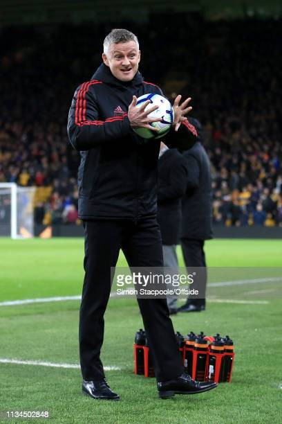 Man Utd manager Ole Gunnar Solskjaer gets a feel of the matchball before the Premier League match between Wolverhampton Wanderers and Manchester...
