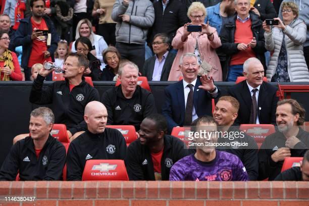 Man Utd manager Sir Alex Ferguson waves as he sits alongside Man Utd assistant Steve McClaren Teddy Sheringham of Man Utd and former assistant Jimmy...