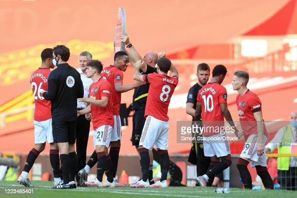 Man Utd players come and go as the manager makes five substitutions at once during the Premier League match between Manchester United and Sheffield...