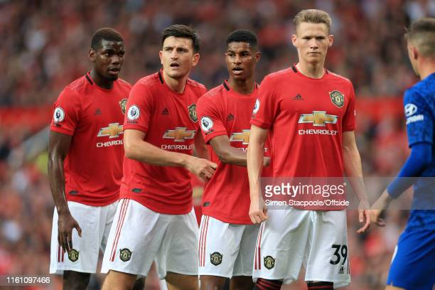 Man Utd players Paul Pogba Harry Maguire Marcus Rashford and Scott McTominay line up during the Premier League match between Manchester United and...