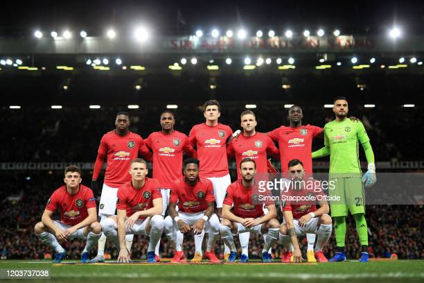 Man Utd players pose for a team group photo before the UEFA Europa League round of 32 second leg match between Manchester United and Club Brugge at...