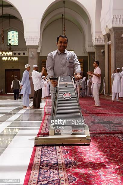 man vacuuming kuba mosque,medina, s.arabia - al madinah stock photos and pictures