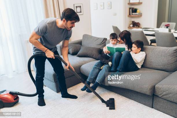 man vacuuming - husband stock pictures, royalty-free photos & images