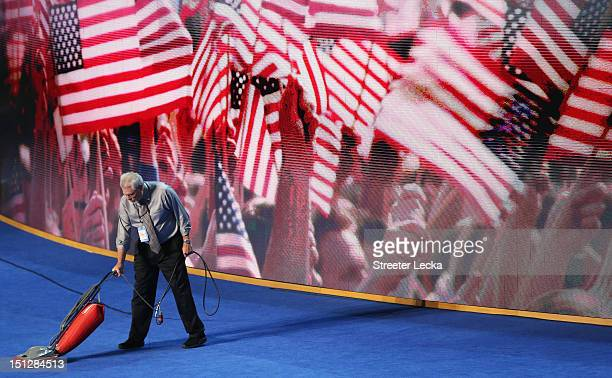 A man vacuums the stage during day two of the Democratic National Convention at Time Warner Cable Arena on September 5 2012 in Charlotte North...