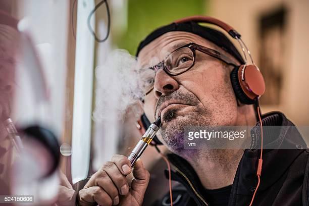 Man vaping electronic cigarette