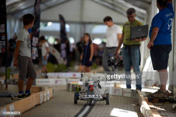 A man verifies how his robot will compete during a try A robots race took place in Toulouse Machines are either cars or walking robots They were...
