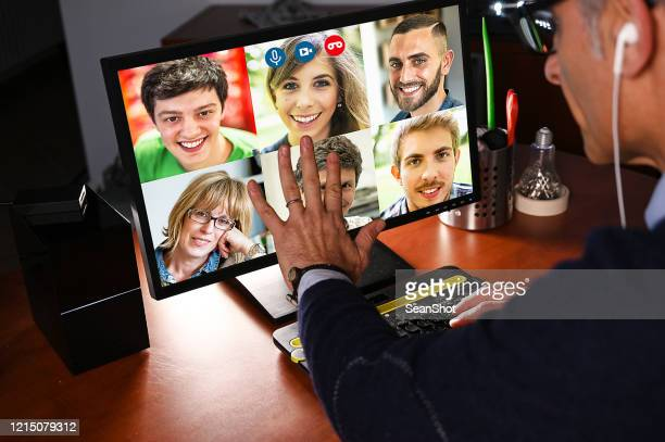 man video chatting with a group of people - employee engagement stock pictures, royalty-free photos & images
