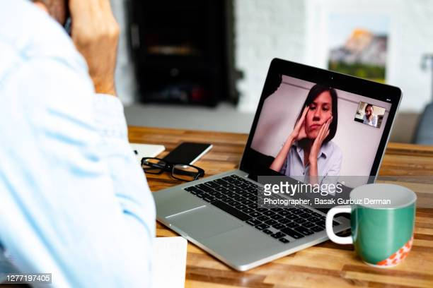 a man video conferencing with a woman - boredom stock pictures, royalty-free photos & images
