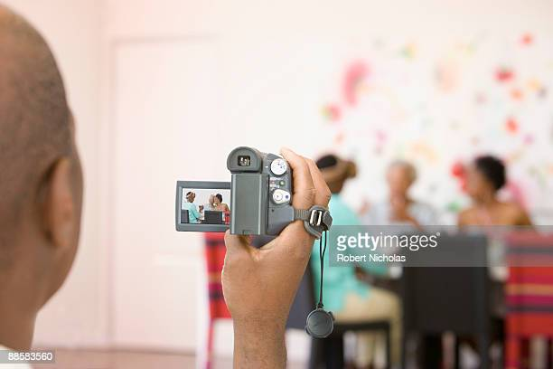 Man videoing family at home