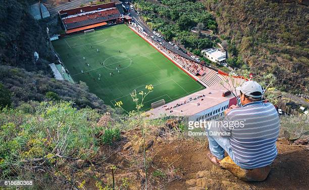 man viewing football match of cd mensajero club (la palma. canary islands) - club football stock-fotos und bilder