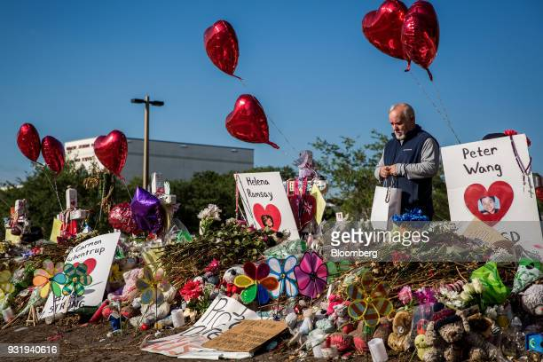 A man views a memorial for the 17 students killed in the shooting at Marjory Stoneman Douglas High School before the ENOUGH National School Walkout...