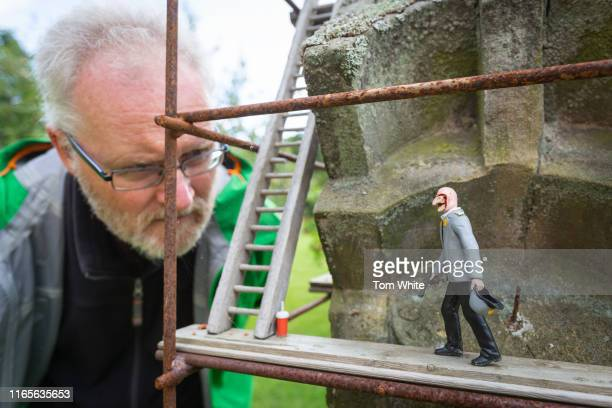 A man views a miniature character in the Astronomer art installation by Peter Hanmer at Cheeseburn Grange on September 2 2019 in Stamfordham England...