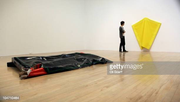 A man views artwork by Angela de la Cruz which has been shortlisted for the Turner Prize 2010 and displayed in the Tate Britain gallery on October 4...
