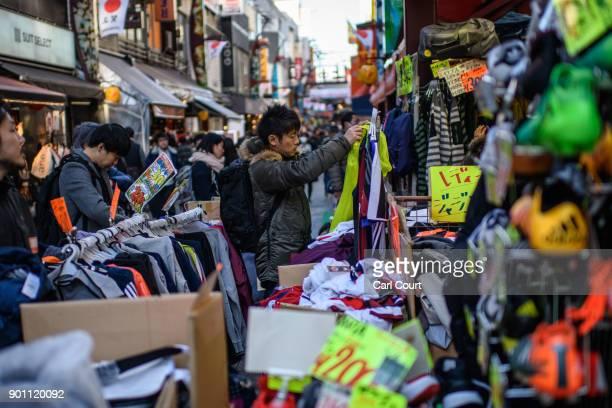 A man views clothes at a discount shop in Ameya Yokocho market on January 4 2018 in Tokyo Japan Ameya Yokocho claimed to be Tokyo's last remaining...