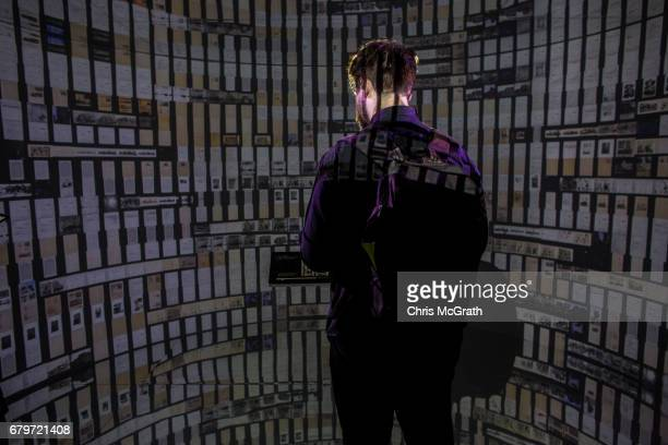 A man views historical documents and photographs displayed in a high tech art installation at Salt Galata on May 6 2017 in Istanbul Turkey The...