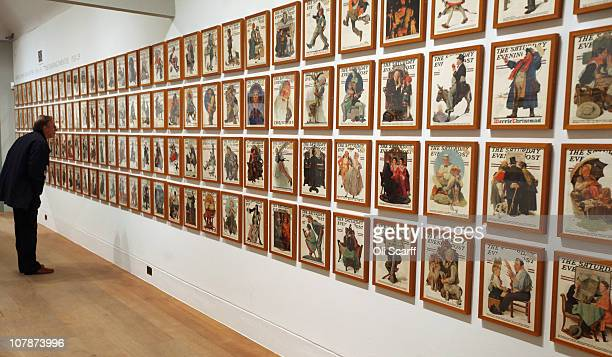 A man views magazine front covers drawn by American Norman Rockwell in Dulwich Picture Gallery which celebrates its bicentenary this year on January...