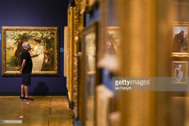 Man views paintings as the Laing Art Gallery re-opens to the public on August 10, 2020 in Newcastle upon Tyne, England. As Coronavirus pandemic...