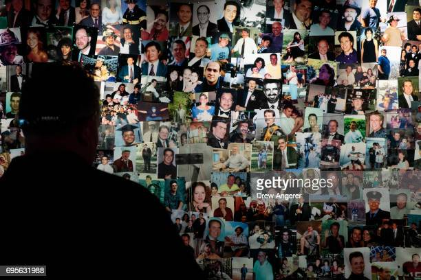 A man views photographs of victims in the new 9/11 Tribute Museum June 13 2017 in New York City The new 9/11 Tribute Museum is officially opening...