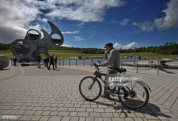 A man views the Falkirk wheel on the Forth and Clyde canal on May 26 2009 in Falkirk in Scotland The canal which crosses Scotland providing a route...
