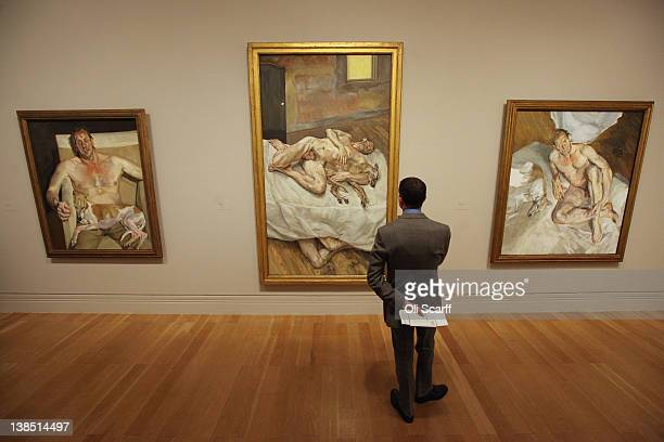 A man views the Lucian Freud painting 'Sunny Morning Eight Legs' in the 'Lucian Freud Portraits' exhibition at the National Portrait Gallery on...
