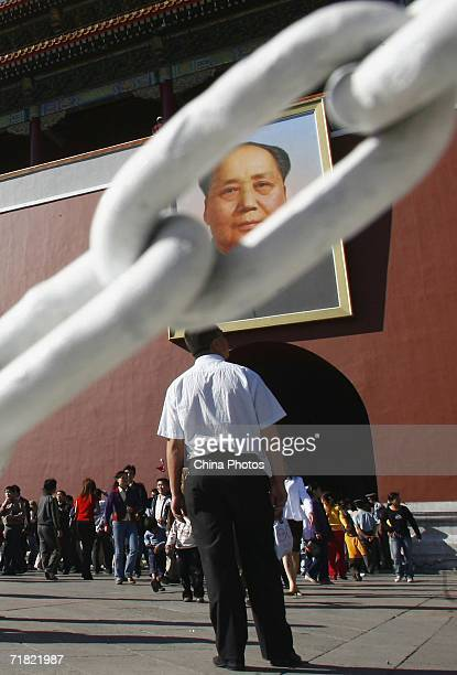 A man views the portrait of former Chinese leader Mao Zedong on the Tiananmen Gate on September 8 2006 in Beijing China September 9 2006 marks the...
