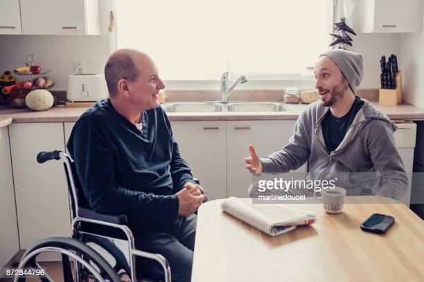 """man visiting a temporary disabled friend and having a coffee. - """"martine doucet"""" or martinedoucet stock pictures, royalty-free photos & images"""