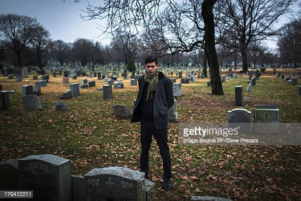 Man visiting graveyard