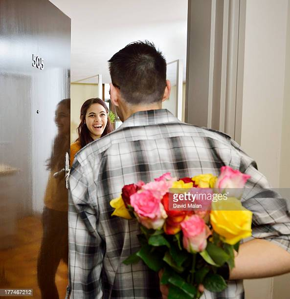 Man visiting his girlfriend bringing flowers.