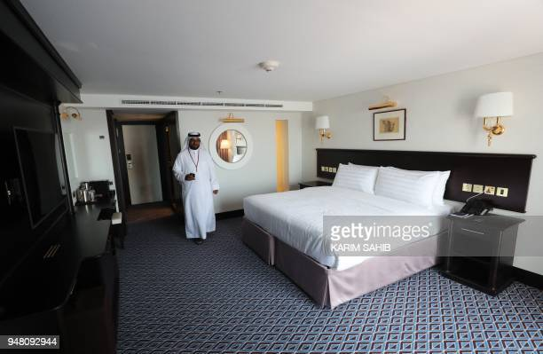 A man visits a duplex suite on The Queen Elizabeth II luxury cruise liner also known as the QE2 docked at Port Rashid in Dubai where it will be...