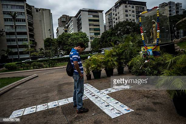 A man visits a memorial at Altamira Plaza for opposition protesters who have been injured or killed by government forces since the start of...