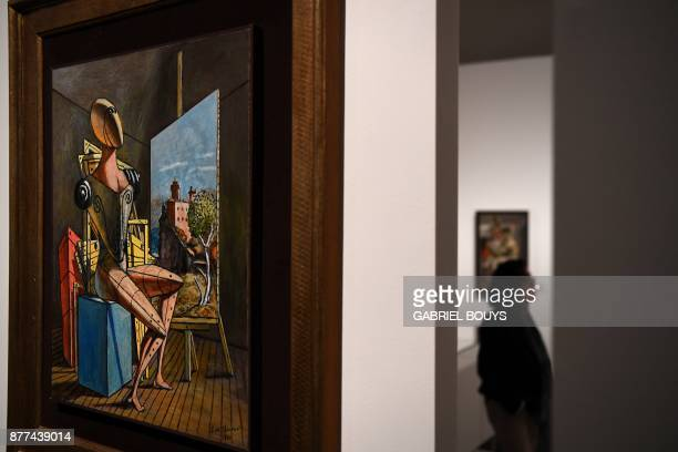 A man visits an exhibit by Italian artist Giorgio De Chirico at the Caixa Forum in Madrid on November 22 2017 on the eve of its inauguration day /...