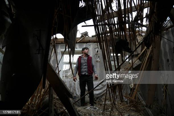 Man visits his home for the first time after it was hit by shelling as a ceasefire begins during the fighting over the breakaway region of...