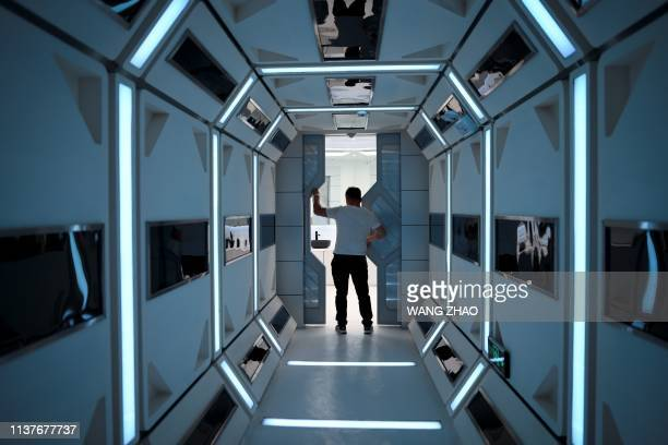 A man visits Mars Base 1 a CSpace Project in the Gobi desert some 40 kilometres from Jinchang in China's northwest Gansu province on April 17 2019...