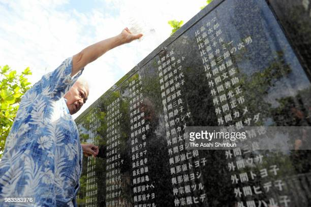 A man visits the Cornerstone of Peace where the names of their bereaved family members and relatives engraved at the Peace Memorial Park on the 73rd...
