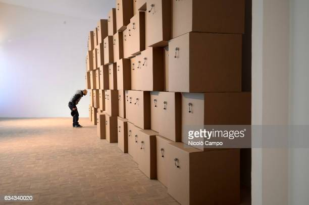 Man visits the exhibition '605 prepared dc-motors, cardboard boxes' of Swiss artist Zimoun. Zimoun is famous for his sound sculptures in which he...