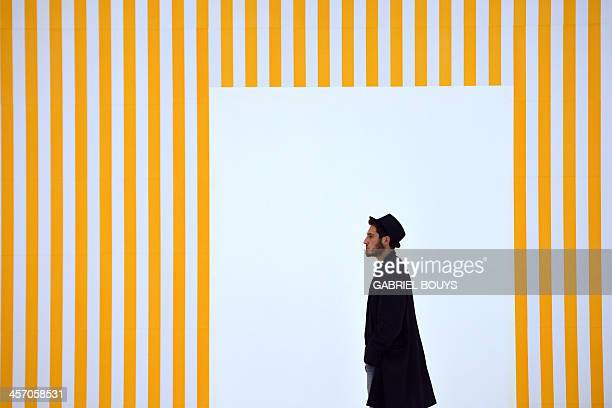 A man visits the exhibition Anni 70 Arte a Roma during a press preview at the Palazzo delle Esposizioni on December 16 2013 in Rome Almost two...