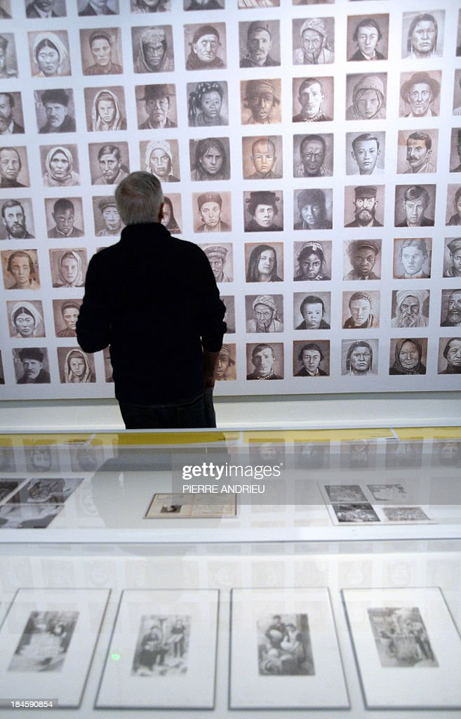 A man visits the exhibition entitled 'Bande dessinée et Immigration. 1913-2013' (Comics and Immigration, 1913-2013) at the Museum of the History of Immigration in Paris on October 14, 2013. The exhibition will run from October 16 until April 27, 2014.