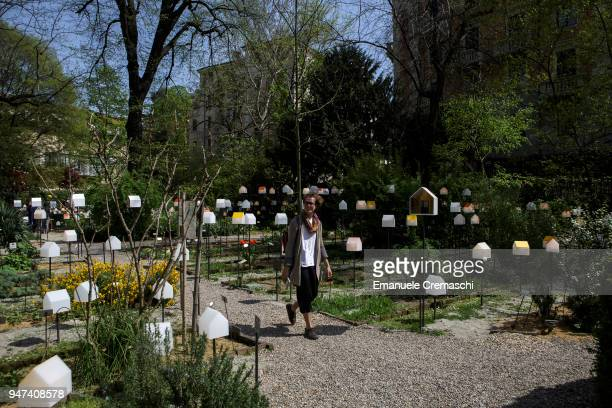 A man visits the installation 'smarTown' at the Brera Botanical Garden on April 16 2018 in Milan Italy Every year Salone and Fuorisalone define the...