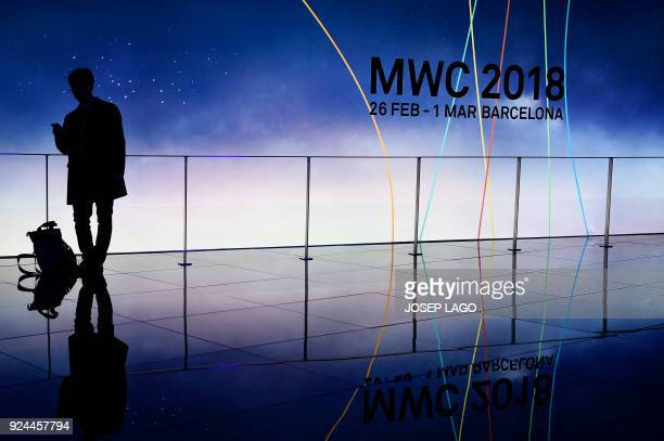 A man visits the Mobile World Congress the world's biggest mobile fair on February 26 2018 in Barcelona the Mobile World Congress is held in...