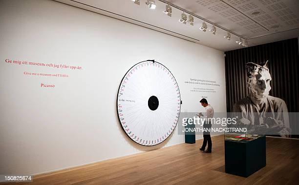 A man visits the Picasso/Duchamp 'He was wrong' exhibition at the Moderna Museet in Stockholm on August 23 2012 In the exhibition Picasso/Duchamp 'He...