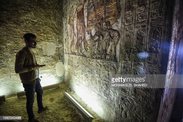 A man visits the tomb of the ancient Egyptian high priest MeryRa at the archaeological site of Tal ElAmarna containing the ruins of Akhetaten the...