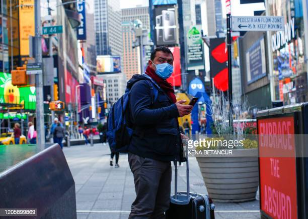 A man visits Times Square as she wears a face mask on March 8 2020 in New York City The governor of New York on March 7 2020 announced a state of...