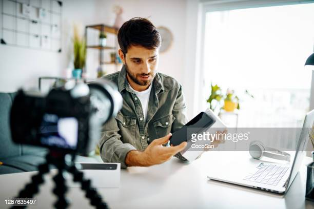 man vlogging from home - unboxing stock pictures, royalty-free photos & images